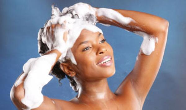 African-American-woman-shampooing-hair-triangle