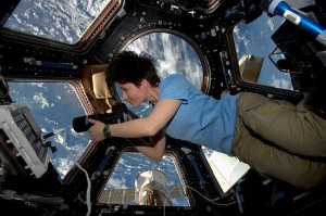 European Space Agency (ESA) astronaut Samantha Cristoforetti, a Flight Engineer with Expedition 42, photographs the Earth through a window in the Cupola on the International Space Station.