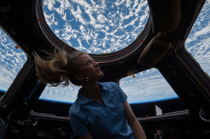 NASA astronaut Karen Nyberg, Expedition 37 flight engineer, enjoys the view of Earth from the windows in the Cupola of the International Space Station