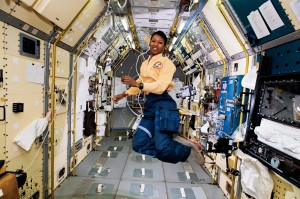 STS-47 Mission Specialist Mae Jemison appears to be clicking her heels in zero gravity in the center aisle of the Spacelab Japan (SLJ) science module aboard the Earth-orbiting Endeavour, Orbiter Vehicle (OV) 105. // NASA //