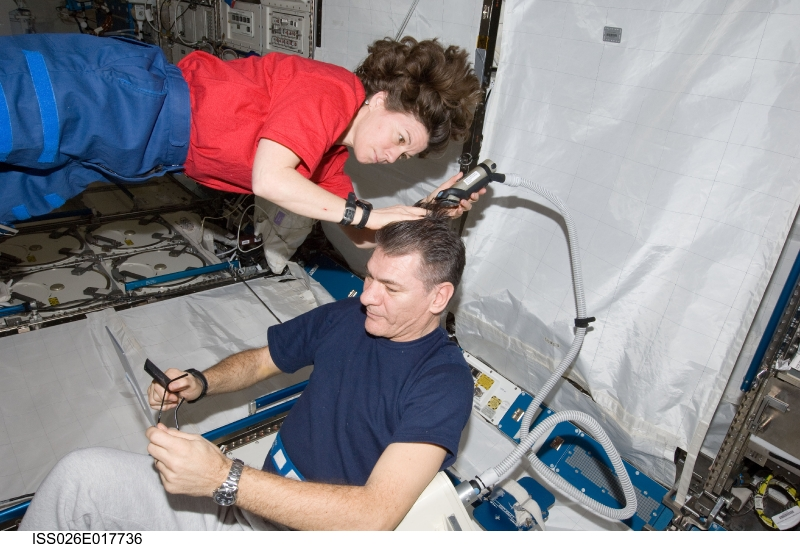 Interstellar haircut with astronauts Cady Coleman and Paolo Nespoli