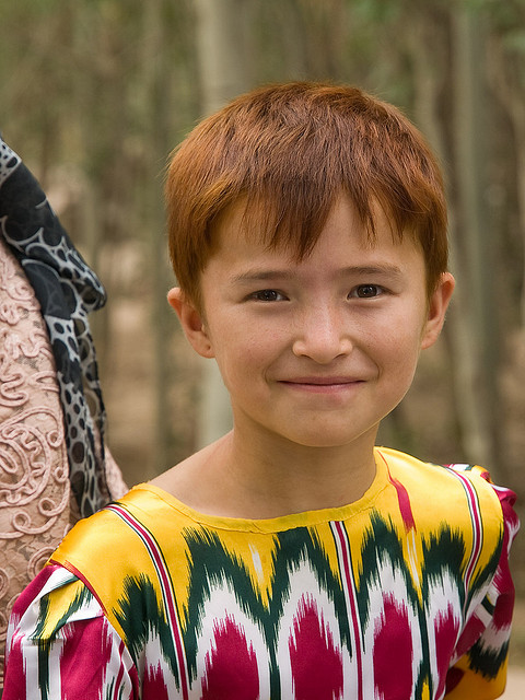 A Uyghur girl with red hair from China's Xinjiang region